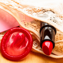 Condom and lipstick on lace lingerie