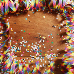 Colorful carnival frame of streamers and confetti