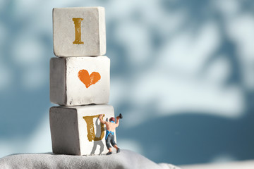 "craftsman working on stones  with "" I LOVE U "" words , Valentine"