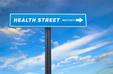 Health street next exit slogan on the street sign against cloudy