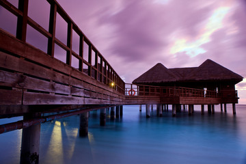 Over water bungalows at sunset.