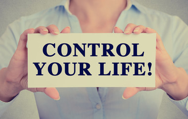 Businesswoman hands holding card sign control your life message