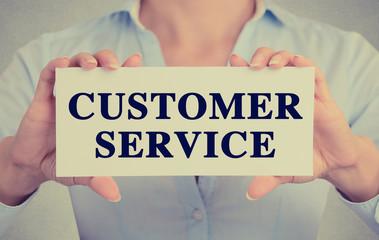 Businesswoman hands holding card sign customer service message
