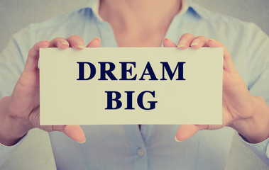 businesswoman hands holding card dream big text sign