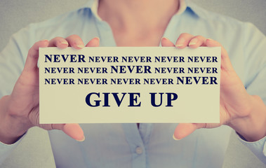 businesswoman hands holding card never give up sign message