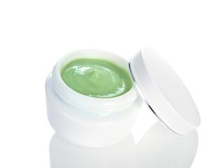 Pot of moisturising cream on white background