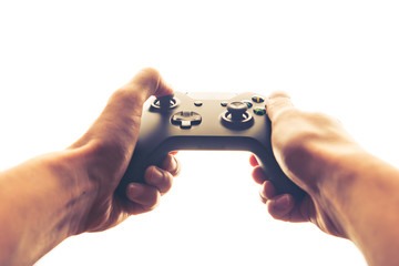 hands playing joystick