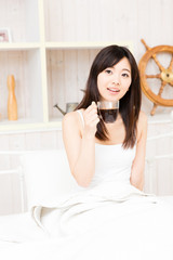 young asian woman relaxing in the bed room