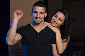 Couple Playing Darts