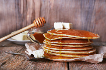 Stack of pancakes with honey and butter