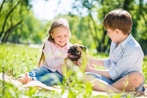 canvas print picture Children in park with pet