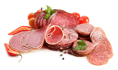 Various sliced salami with chili pepper, cherry tomatoes and