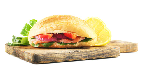 Sandwich with salmon on wooden board isolated on white