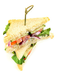 Club sandwiches with salmon  and vegetables isolated on white