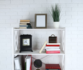 Bookshelves with books and decorative objects
