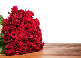 Colorful flower bouquet from red roses isolated on wooden backgr