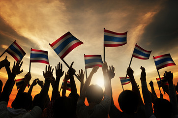 Group People Waving Flag Thailand in Back Lit Concept