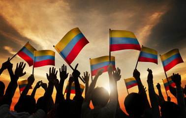 Group People Waving Columbian Flags Back Lit Concept