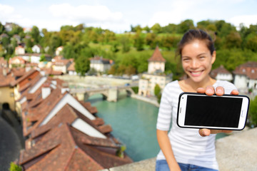 Smartphone screen - Woman showing app in Bern