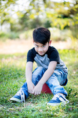 Portrait of asian cute little boy at the park