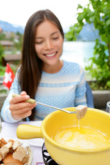 Cheese fondue - woman eating Swiss food