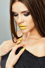 Beauty face portrait . Lips, Nails Yellow.