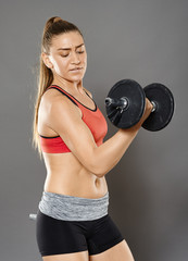 Fitness girl working with weights