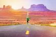 Runner man athlete running on road Monument Valley