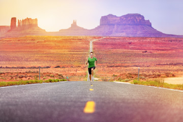 Runner man athlete running on road Monument Valley