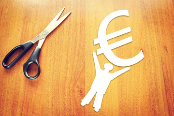 Abstract man holding a sign of euro at the hands