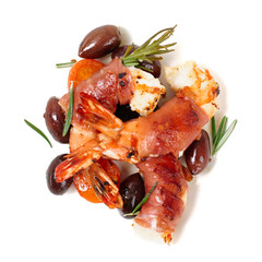 Shrimps with bacon, olives and rosemary, isolated