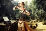 Fototapety Attractive young woman playing on violin outdoors.