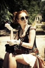 Beautiful  steampunk woman smoking