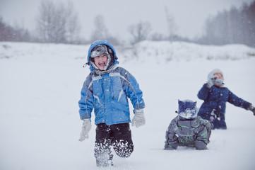 Children throw snow