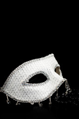 Silver glittering mask and black pearls