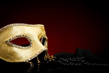 Decorated golden mask and pearls