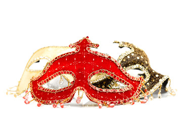 Red carnival mask in the front