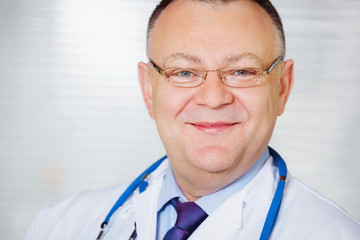 Portrait of Doctor with stethoscope looking at the camera.
