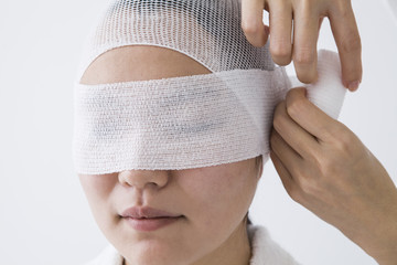Women bandaged eyes