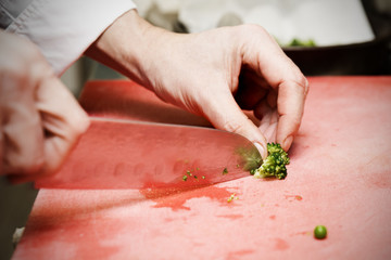 Chef is cutting vegetables, toned image
