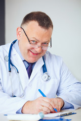 Portrait of funny doctor prescribing drugs.