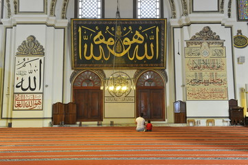 father and son in the mosque