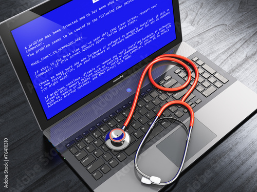canvas print picture Laptop with blue error screen and stethoscope