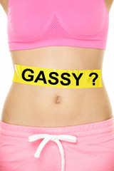 Conceptual Woman Stomach with Gassy Text on Tape