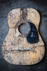 Broken acoustic guitar
