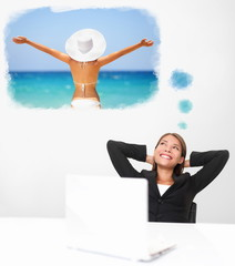 Smiling businesswoman dreaming of the beach travel