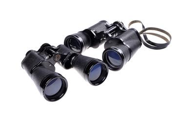 Old vintage binoculars on a white background .