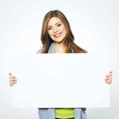 smiling girl holding blank sign board.