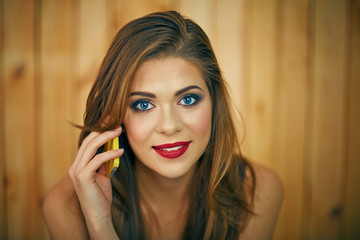 Smiling woman talkin phone. Beautiful girl face portrait