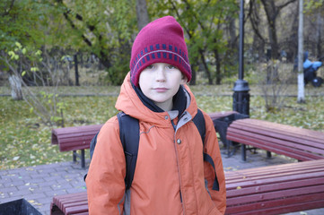 the teenage boy's portrait in autumn park.